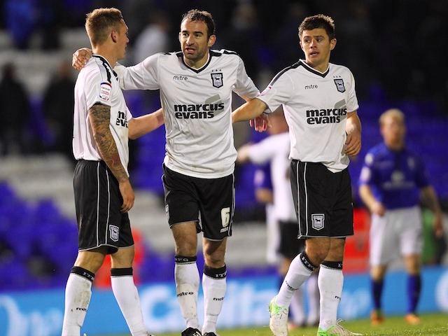 Danny Higginbotham Luke Chambers and Aaron Cresswell celebrate for Ipswich