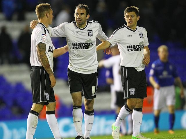 Danny Higginbotham Luke Chambers and Aaron Cresswell celebrate for Ipswich
