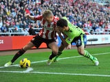 Sebastian Larsson of Sunderland and Eric Lichaj of Aston Villa