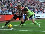 Sebastian Larsson of Sunderland and Eric Lichaj of Aston Villa