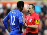 Ref Kevin Friend has a word with Mikel