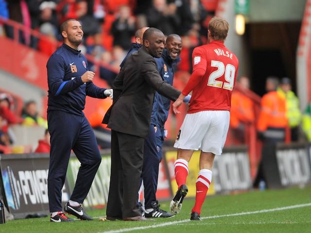 Rob Hulse celebrates with Chris Powell after scoring Charlton's first