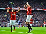 Robin van Persie enjoys a muted celebration after scoring United's first