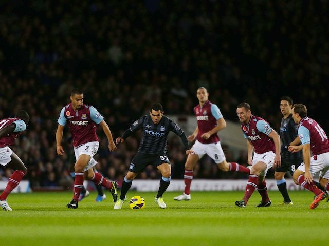 Carlos Tevez and an assortment of West Ham players