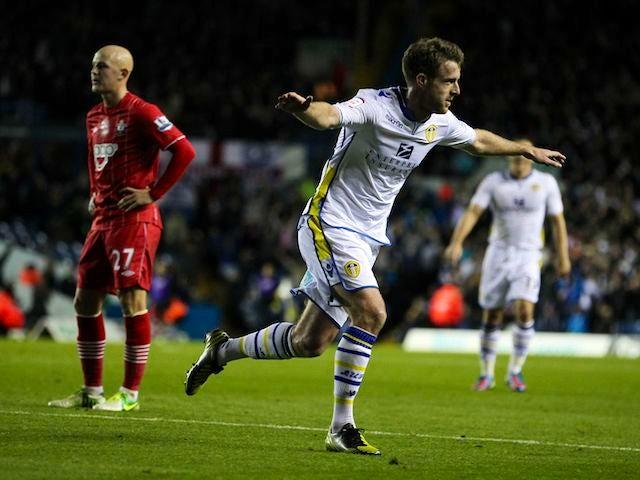 Michael Tonge celebrates scoring Leeds's first over Southampton