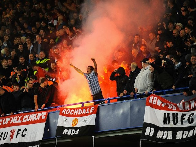 United fans let off a flare in the stands