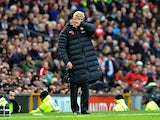 Arsene Wenger and his big puffa jacket