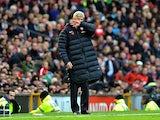 Arsene Wenger and his big puffa jacket