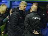 Brian McDermott and Arsene Wenger shake hands at the end of the match