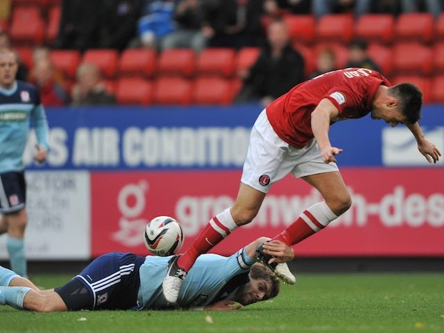 Jonny Jackson is tripped by Middlesbrough's Jonathan Woodgate