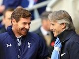 Andre Villas-Boas and Roberto Mancini having a laugh before kickoff