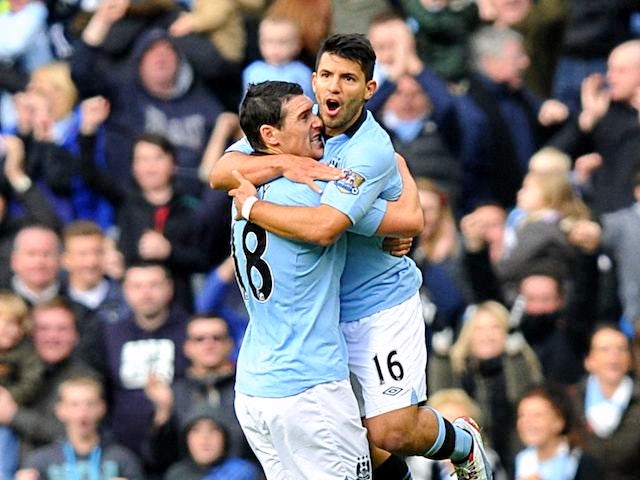 Sergio Aguero celebrates with Gareth Barry after scoring City's equaliser