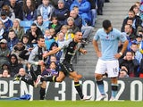 Steven Caulker celebrates scoring for Spurs as Aguero stands dejected