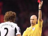 Fabricio Coloccini is shown a red card