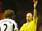 Fabricio Coloccini is shown a red card