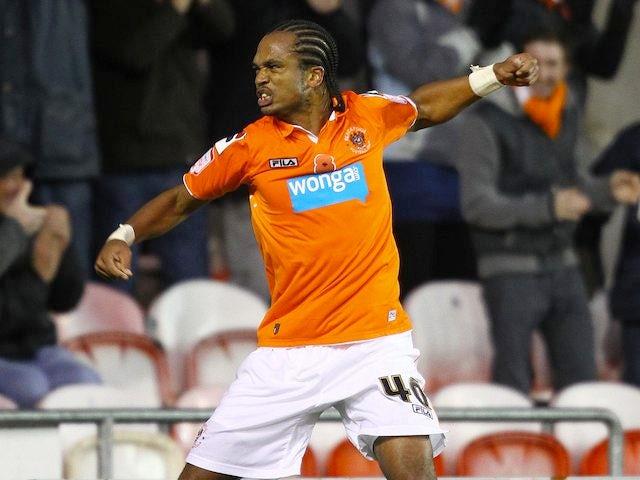 Nathan Delfouneso celebrates scoring for Blackpool