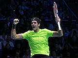 Juan Martin Del Potro celebrates defeating Roger Federer