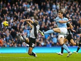Edin Dzeko scores the winner for City