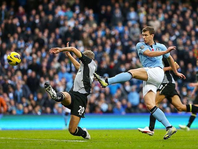 Edin Dzeko scores the winner for City