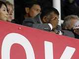 QPR chairman Tony Fernandes hides behind his hands