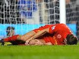 Steven Gerrard lies injured