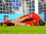 Steven Gerrard lies injured