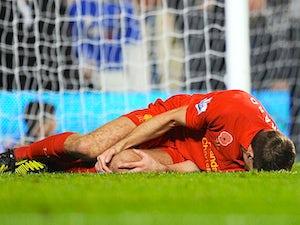 Gerrard to have scan on injured knee