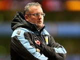 Paul Lambert wrapped up in a coat before kickoff