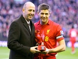 Gary McAllister presents Steven Gerrard with an award for his 600th appearance for Liverpool