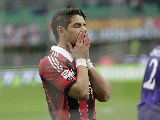 Pato reacts after failing to score a penalty for AC Milan