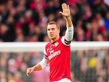 Lukas Podolski celebrates scoring Arsenal's second