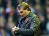 Brendan Rodgers makes notes on the touchline