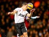 Robin van Persie jumps to head the ball