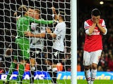 Mark Schwarzer celebrates as Mikel Arteta looks distraught