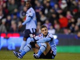 Adel Taarabt sits on the ground after a missed chance