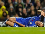 John Terry lies in agony on the ground