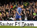 John Terry celebrates scoring the opener for Chelsea