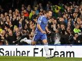 John Terry celebrates scoring the opener for Chelsea