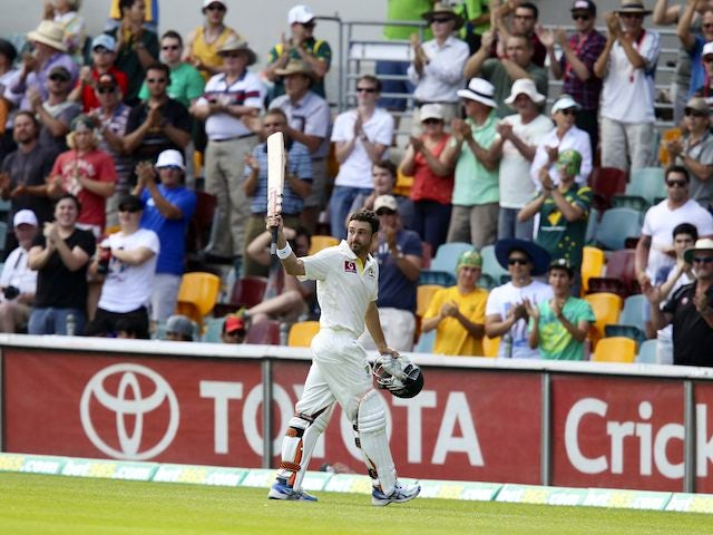 Australia's Ed Cowan leaves the field after being run out for 136
