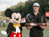 Charlie Beljan celebrates his win with Mickey Mouse