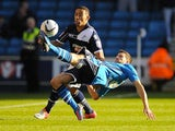 Adam Drury clears the ball away from Liam Feeney on November 18, 2012