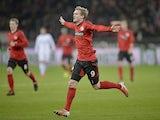 Andre Schuerrle opens the scoring for Bayer Leverkusen on November 17, 2012