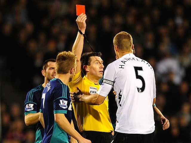Fulham's Brede Hangeland is shown the red card on November 18, 2012