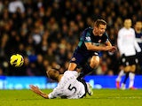 Fulham's Brede Hangeland fouls Sunderland's Lee Cattermole on November 18, 2012