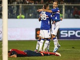 Sampdoria players jump with delight after Genoa's Cesare Bovo scores an own goal on November 18, 2012