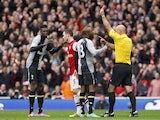 Emmanuel Adebayor is shown red by referee Howard Webb on November 17, 2012