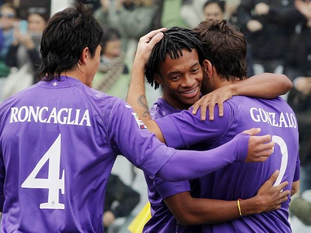 Gonzalo is hugged by Fiorentina teammates after scoring on November 18, 2012