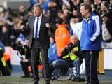 Kenny Jackett celebrates Millwall's win as Neil Warnock stands nearby on November 18, 2012