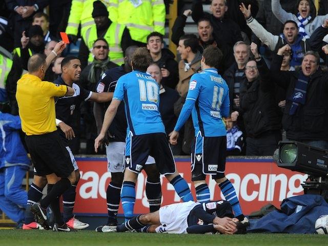 Leeds United's Luke Varney is shown the red card by Mark Halsey on November 18, 2012