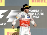 Lewis Hamilton is happy after winning the US Grand Prix on November 18, 2012